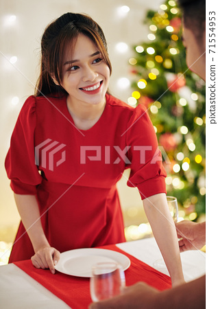 Decorating table for Christmas dinner 71554953