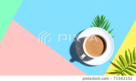 A cup of coffee with tropical leaves 71563102