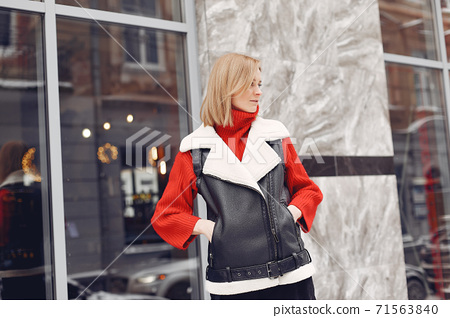 Winter time in big city of charming girl standing on street 71563840