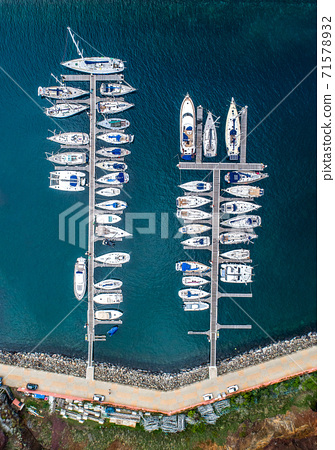 The drone aerial view of sailing yachts moored in marina Quinta do Lorde on coast of the Portuguese island of Madeira 71578932