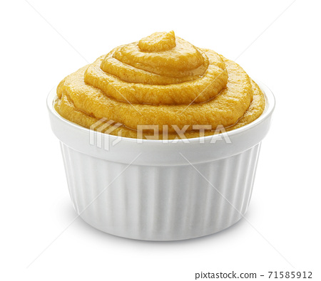 Mustard in bowl isolated on white background 71585912