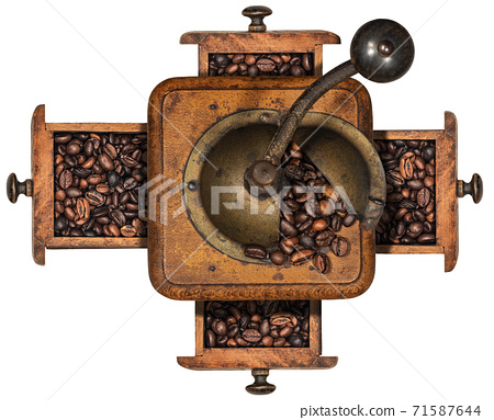 Manual Coffee Grinder and Roasted Coffee Beans isolated on white 71587644