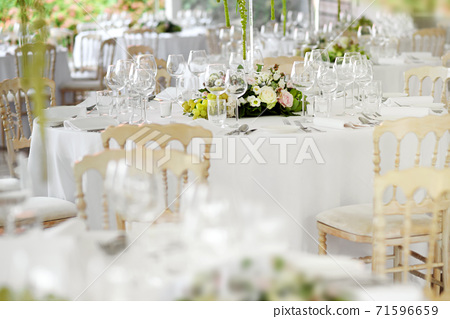 Formal table settings at a wedding venue 71596659