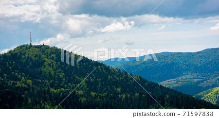 rolling hills of mountain landscape. cloudy day in carpathian mountains. ridge in the distance. beautiful nature background in springtime 71597838