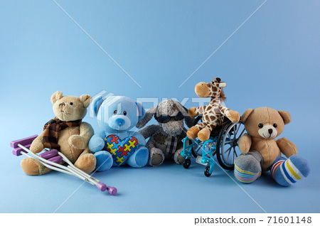 International day of persons with disabilities. Wheelchair with toys sign of different disabilities on blue background. 71601148