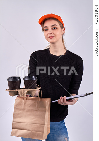 European female courier with coffee and paper package. 71601964
