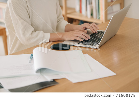 Hands of women doing home work, telework, and remote 71608178