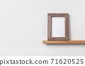 vertical wood photo on bookshelf 71620525