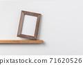 vertical wood photo on bookshelf 71620526