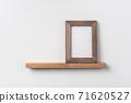 vertical wood photo on bookshelf 71620527