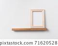 vertical wood photo on bookshelf 71620528