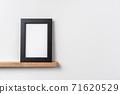 vertical black wood photo on bookshelf 71620529