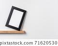 vertical black wood photo on bookshelf 71620530