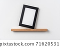 vertical black wood photo on bookshelf 71620531