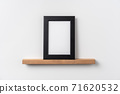 vertical black wood photo on bookshelf 71620532