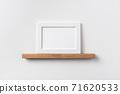 horizontal white wood photo on bookshelf 71620533