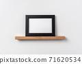 horizontal black wood photo on bookshelf 71620534