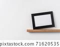 horizontal lack wood photo on bookshelf and wall 71620535