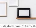 horizontal white and black wood photo on bookshelf 71620536
