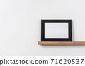 horizontal lack wood photo on bookshelf and wall 71620537