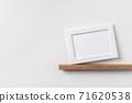 horizontal white wood photo on bookshelf and wall 71620538
