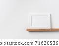 horizontal white wood photo on bookshelf and wall 71620539