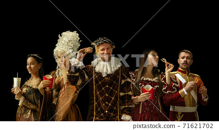 Medieval people as a royalty persons in vintage clothing on dark background. Concept of comparison of eras, modernity and renaissance. Creative collage. 71621702