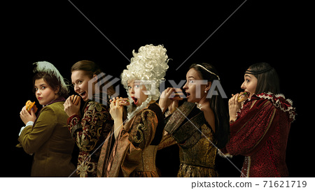 Medieval people as a royalty persons in vintage clothing on dark background. Concept of comparison of eras, modernity and renaissance. Creative collage. 71621719