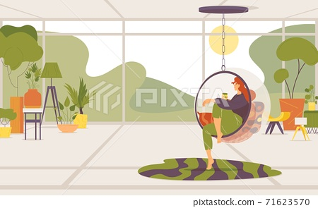 Woman in transparent bubble chair relaxed sitting. Lots of flower pots, greenery and interior design elements, large window and peaceful landscape. 71623570