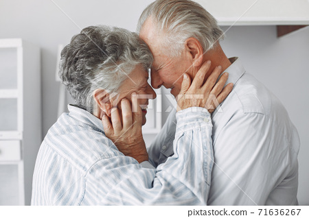 Beautiful old couple spent time together at home 71636267