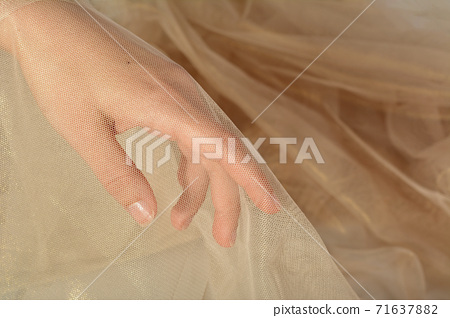 elegant women's hand with elastic fabric organza tulle mesh. for sewing wedding and masquerade dresses. 71637882