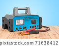Battery charger on the wooden planks, 3D rendering 71638412
