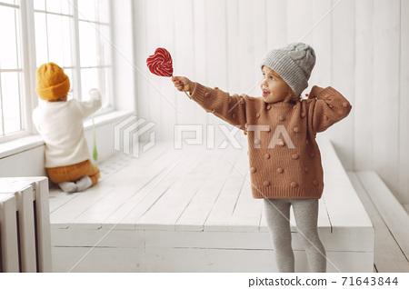 Cute children have fun in a studio 71643844