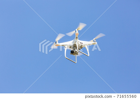 Blue sky and drone 71655560