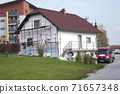 Facade thermal insulation and painting works, scaffolding in a village 71657348