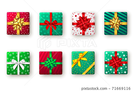Gift box with green, red, golden ribbon and bow, top view. 71669116