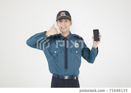 Asian male and female two police officers 020 71686135