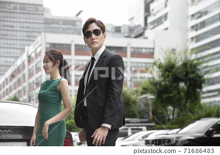 Asian male and female two security guards 027 71686483