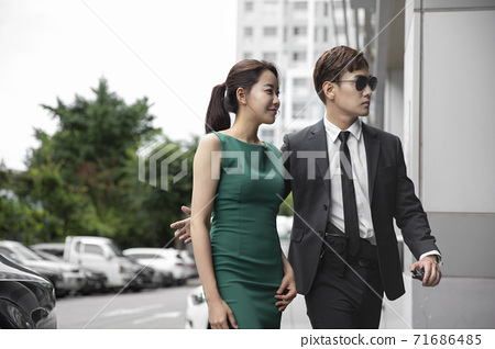 Asian male and female two security guards 026 71686485