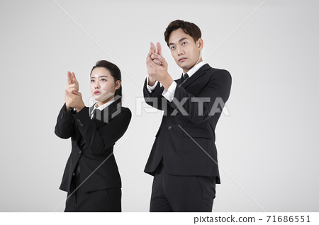 Asian male and female two security guards 064 71686551