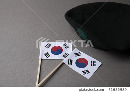 Military symbols concep, South Korean flag and folded military uniform 13 71686989