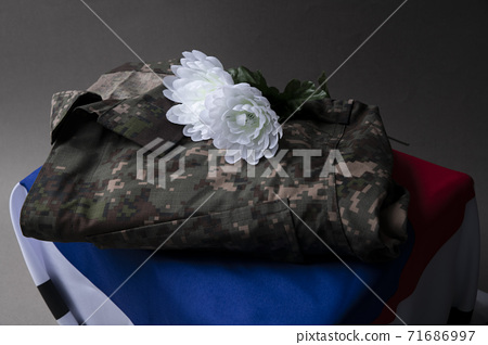 Military symbols concep, South Korean flag and folded military uniform 21 71686997