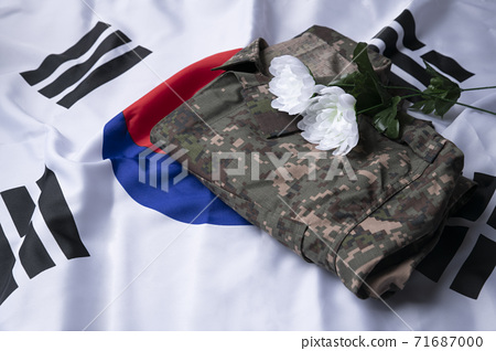 Military symbols concep, South Korean flag and folded military uniform 24 71687000