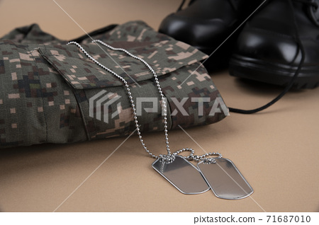 Military symbols concep, South Korean flag and folded military uniform 34 71687010