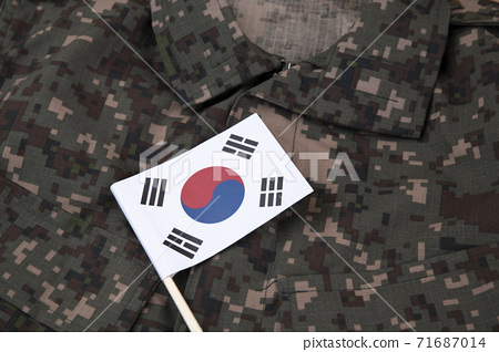 Military symbols concep, South Korean flag and folded military uniform 37 71687014