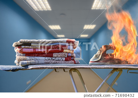 The clothes iron forgotten not turned on overheated and caused a home fire. 71698432