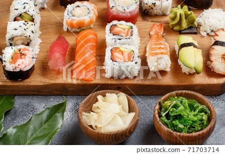 Sushi Set nigiri and sushi rolls on a wooden tray 71703714