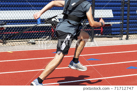 Runner pulling weighted sled on a track 71712747