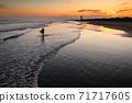 Kujukuri beach and surfers at dusk 71717605