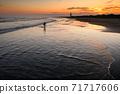 Kujukuri beach and surfers at dusk 71717606